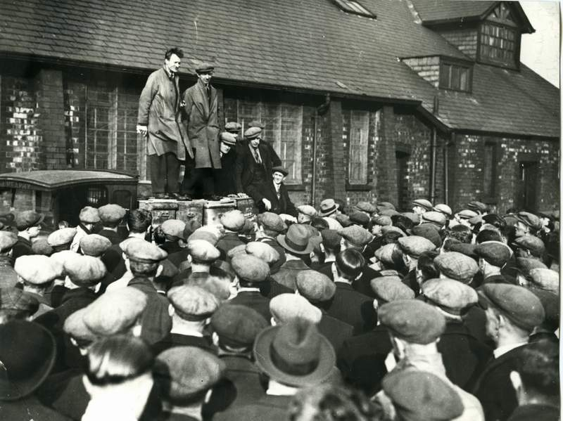 Strike leaders Alf Bywater and Bill Dunn are shown addressing the workers.
